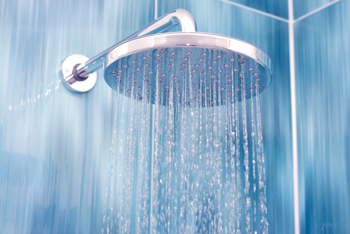waterfall showerhead on blue tile background